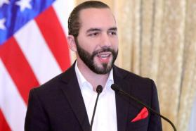 Nayib Bukele speaks in front of an American flag at the US Embassy in El Salvador